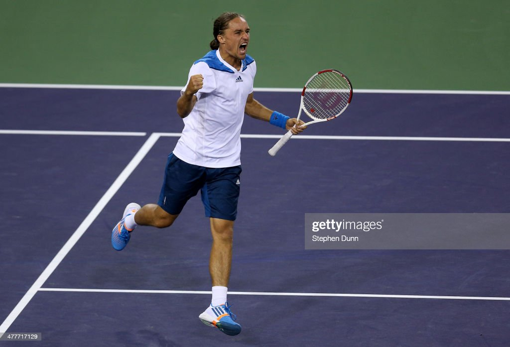 <a gi-track='captionPersonalityLinkClicked' href=/galleries/search?phrase=Alexandr+Dolgopolov&family=editorial&specificpeople=7025085 ng-click='$event.stopPropagation()'>Alexandr Dolgopolov</a> of The Ukraine celebrates after winning match point against Rafael Nadal of Spain during the BNP Paribas Open at Indian Wells Tennis Garden on March 9, 2014 in Indian Wells, California. Giorgi won 6-3, 4-6, 7-5. (Photo by Stephen Dunn/Getty Images).