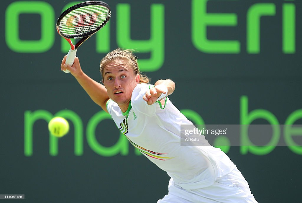 Alexandr Dolgopolov of the Ukraine lines up a return shot against JoWilfried Tsonga of France during the Sony Ericsson Open at Crandon Park Tennis...