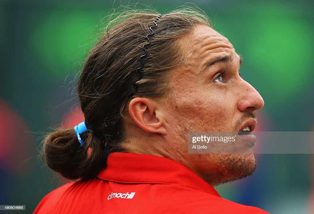 Alexandr Dolgopolov of the Ukraine looks on against Tomas Berdych of Czech Republic during their match on day 11 of the Sony Open at Crandon Park...