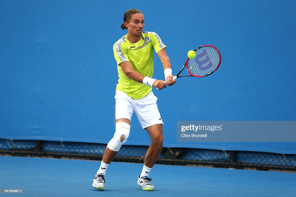 Alexandr Dolgopolov of the Ukraine plays a backhand in his first round match against Paolo Lorenzi of Italy during day two of the 2015 Australian...