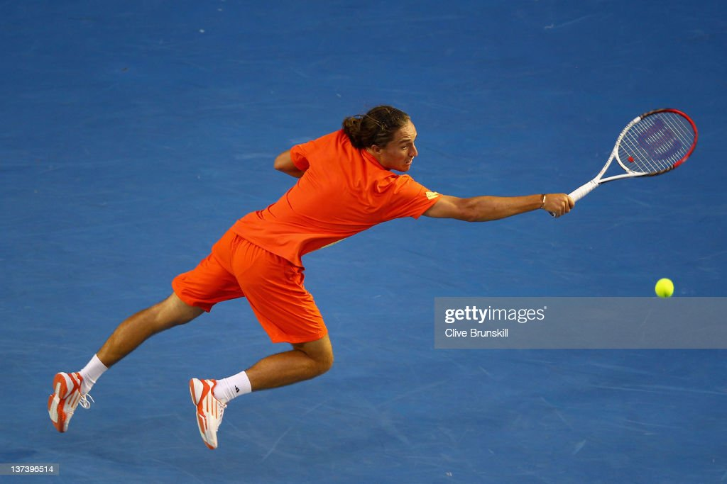 Alexandr Dolgopolov of the Ukraine plays a backhand in his third round match against Bernard Tomic of Australia during day five of the 2012...