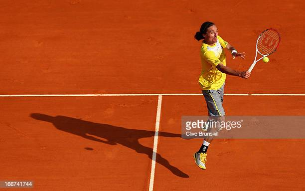 Alexandr Dolgopolov of the Ukraine plays a backhand volley against Juan Martin Del Potro of Argentina in their second round match during day three of...