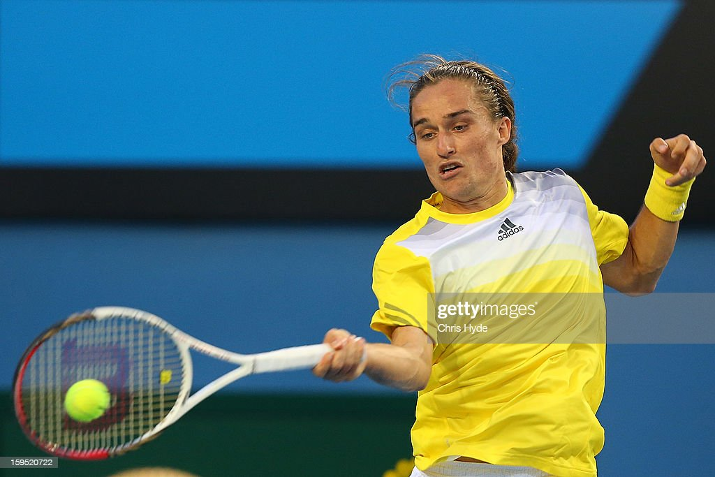 Alexandr Dolgopolov of the Ukraine plays a forehand in his first round match against Gael Monfils of France during day two of the 2013 Australia during day two of the 2013 Australian Open at Melbourne Park on January 15, 2013 in Melbourne, Australia.