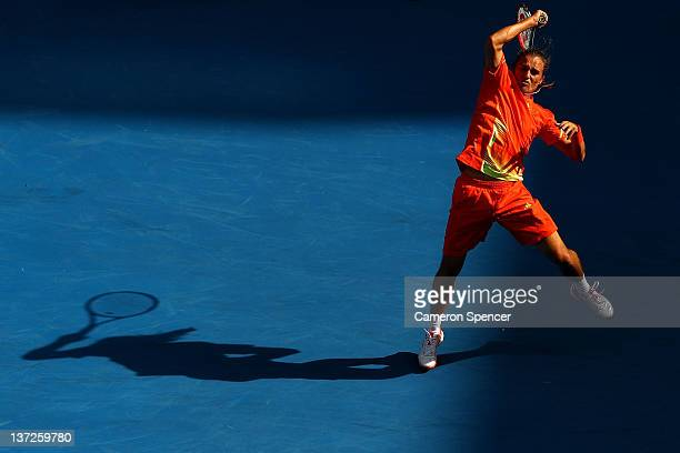 Alexandr Dolgopolov of the Ukraine plays a forehand in his second round match against Tobias Kamke of Germany during day three of the 2012 Australian...