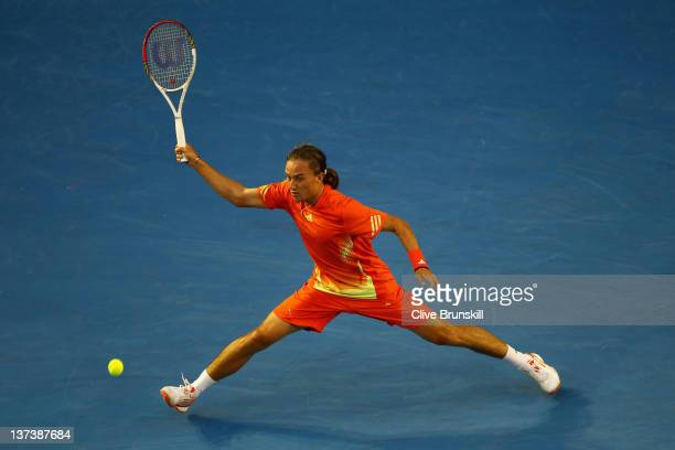 Alexandr Dolgopolov of the Ukraine plays a forehand in his third round match against Bernard Tomic of Australia during day five of the 2012...