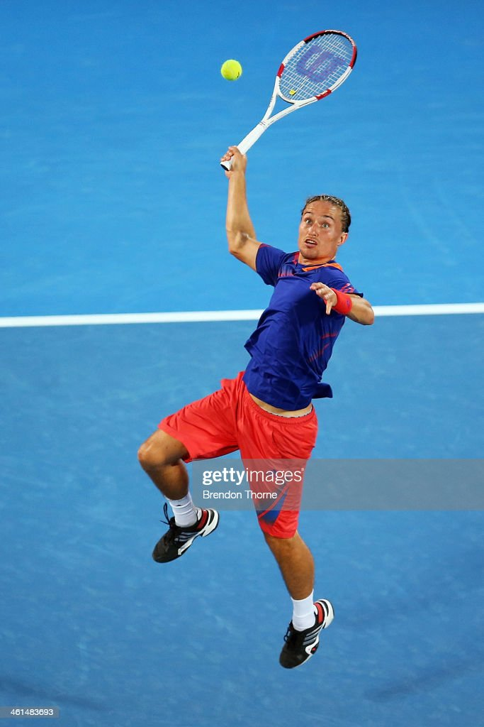 <a gi-track='captionPersonalityLinkClicked' href=/galleries/search?phrase=Alexandr+Dolgopolov&family=editorial&specificpeople=7025085 ng-click='$event.stopPropagation()'>Alexandr Dolgopolov</a> of the Ukraine plays a smash shot in his quarter final match against Bernard Tomic of Australia during day five of the 2014 Sydney International at Sydney Olympic Park Tennis Centre on January 9, 2014 in Sydney, Australia.