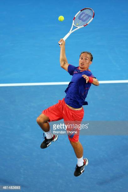 Alexandr Dolgopolov of the Ukraine plays a smash shot in his quarter final match against Bernard Tomic of Australia during day five of the 2014...