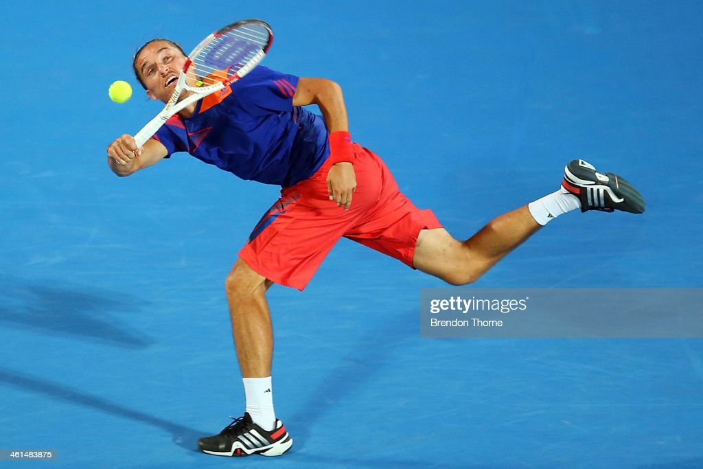 <a gi-track='captionPersonalityLinkClicked' href=/galleries/search?phrase=Alexandr+Dolgopolov&family=editorial&specificpeople=7025085 ng-click='$event.stopPropagation()'>Alexandr Dolgopolov</a> of the Ukraine receives serve in his quarter final match against Bernard Tomic of Australia during day five of the 2014 Sydney International at Sydney Olympic Park Tennis Centre on January 9, 2014 in Sydney, Australia.