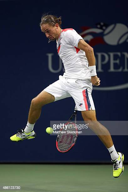 Alexandr Dolgopolov of the Ukraine returns a shot against Sam Groth of Australia during their Men's Singles First Round match on Day One of the 2015...
