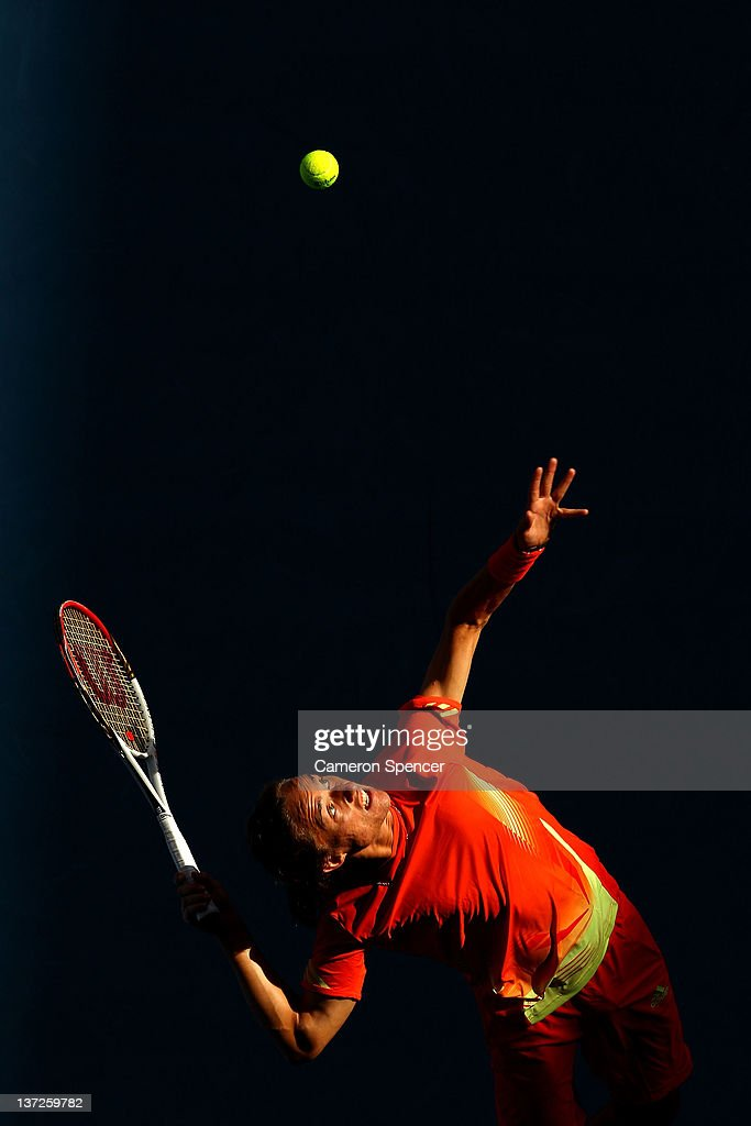 <a gi-track='captionPersonalityLinkClicked' href=/galleries/search?phrase=Alexandr+Dolgopolov&family=editorial&specificpeople=7025085 ng-click='$event.stopPropagation()'>Alexandr Dolgopolov</a> of the Ukraine serves in his second round match against Tobias Kamke of Germany during day three of the 2012 Australian Open at Melbourne Park on January 18, 2012 in Melbourne, Australia.