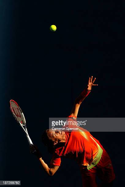 Alexandr Dolgopolov of the Ukraine serves in his second round match against Tobias Kamke of Germany during day three of the 2012 Australian Open at...