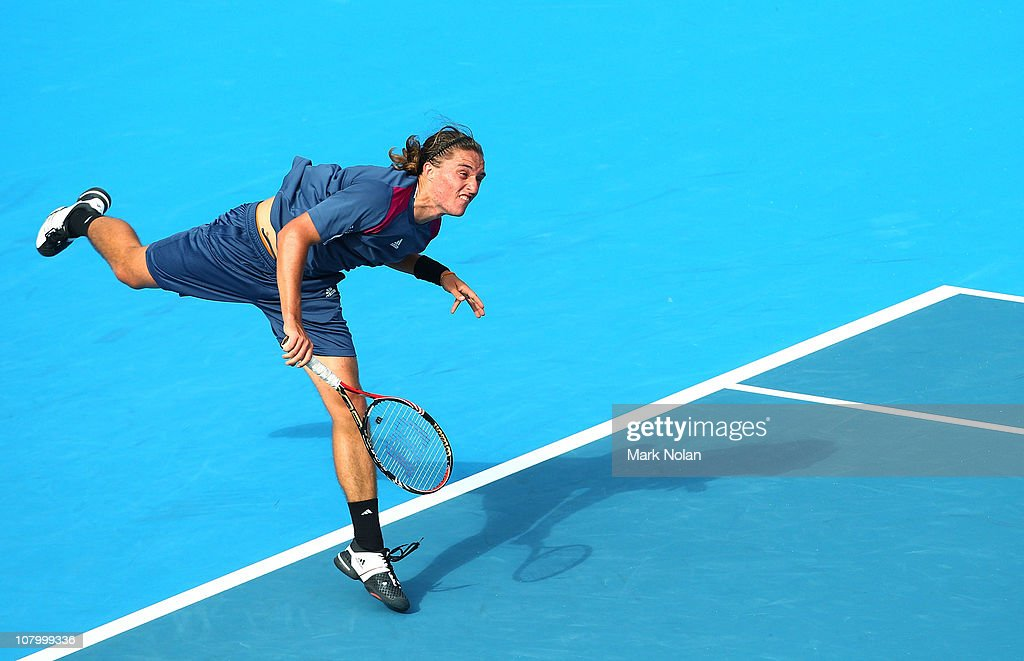 Alexandr Dolgopolov of the Ukraine serves in the match against Sam Querrey of the USA during day four of the 2011 Medibank International at Sydney...