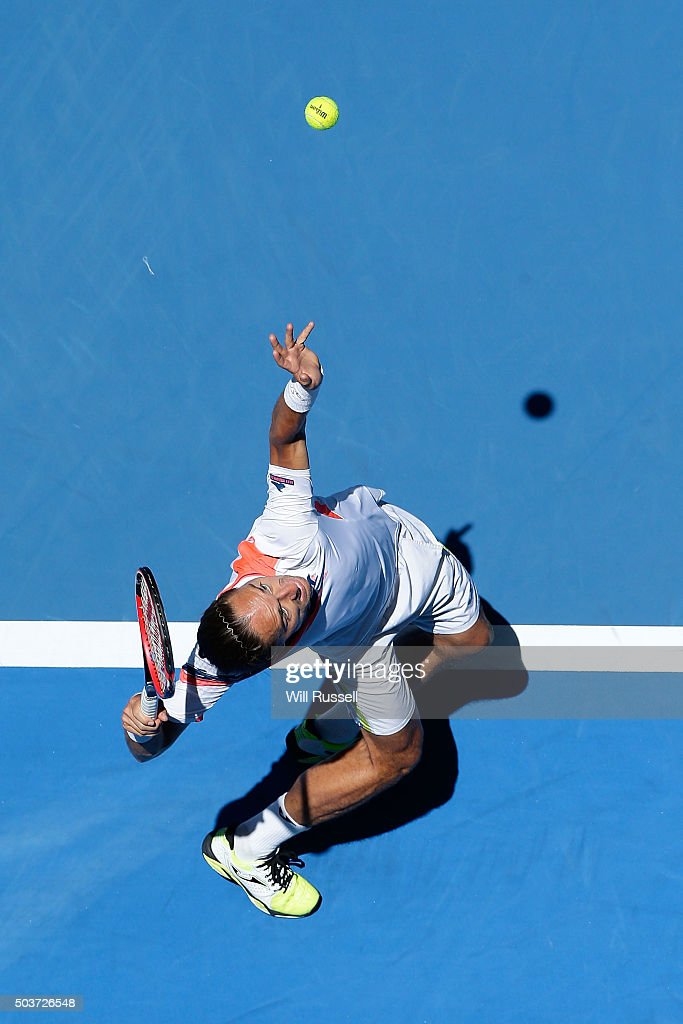 <a gi-track='captionPersonalityLinkClicked' href=/galleries/search?phrase=Alexandr+Dolgopolov&family=editorial&specificpeople=7025085 ng-click='$event.stopPropagation()'>Alexandr Dolgopolov</a> of the Ukraine serves in the men's single match against Lleyton Hewitt of Australia Gold during day five of the 2016 Hopman Cup at Perth Arena on January 7, 2016 in Perth, Australia.