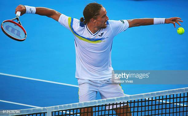 Alexandr Dolgopolov of Ukraine celebrates after winning the game during a singles match between David Ferrer of Spain and Alexandr Dolgopolov of...