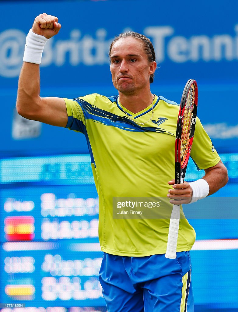 <a gi-track='captionPersonalityLinkClicked' href=/galleries/search?phrase=Alexandr+Dolgopolov&family=editorial&specificpeople=7025085 ng-click='$event.stopPropagation()'>Alexandr Dolgopolov</a> of Ukraine celebrates his victory in his men's singles first round match against Rafael Nadal of Spain during day two of the Aegon Championships at Queen's Club on June 16, 2015 in London, England.