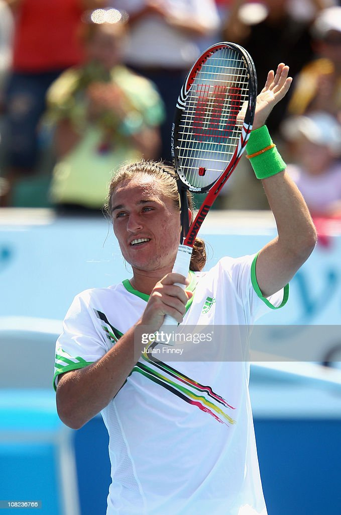 Alexandr Dolgopolov of Ukraine celebrates winning his third round match against JoWilfried Tsonga of France during day six of the 2011 Australian...