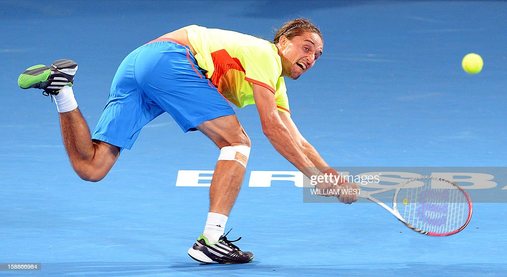 Alexandr Dolgopolov of Ukraine hits a backhand return against Jarkko Nieminen of Finland in the second round at the Brisbane International tennis tournament on January 2, 2013. AFP PHOTO/William WEST USE