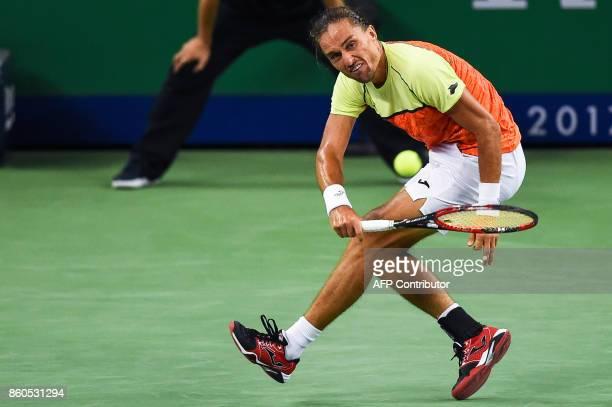 Alexandr Dolgopolov of Ukraine hits a return during the men's singles against Roger Federer of Switzerland at the Shanghai Masters tennis tournament...