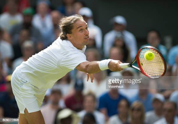 Alexandr Dolgopolov of Ukraine in action against Roger Federer of Switzerland on day two of the Wimbledon Lawn Tennis Championships at the All...