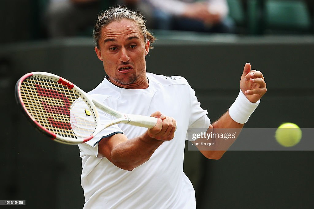 <a gi-track='captionPersonalityLinkClicked' href=/galleries/search?phrase=Alexandr+Dolgopolov&family=editorial&specificpeople=7025085 ng-click='$event.stopPropagation()'>Alexandr Dolgopolov</a> of Ukraine in action during his Gentlemen's Singles third round match against Grigor Dimitrov of Bulgaria on day five of the Wimbledon Lawn Tennis Championships at the All England Lawn Tennis and Croquet Club on June 27, 2014 in London, England.