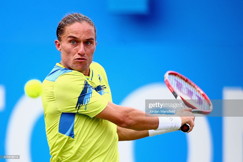 Alexandr Dolgopolov of Ukraine plays a backhand in his men's singles first round match against Rafael Nadal of Spain during day two of the Aegon...