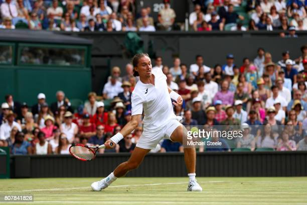 Alexandr Dolgopolov of Ukraine plays a forehand during the Gentlemen's Singles first round match against Roger Federer of Switzerland on day two of...