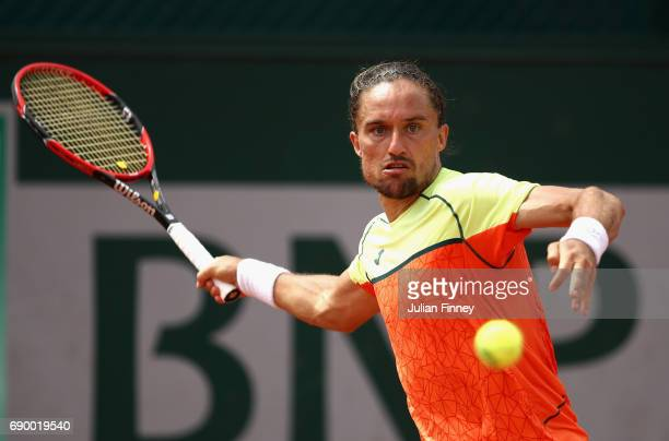 Alexandr Dolgopolov of Ukraine plays a forehand during the mens singles first round match against Carlos Berlocq of Argentina on day three of the...