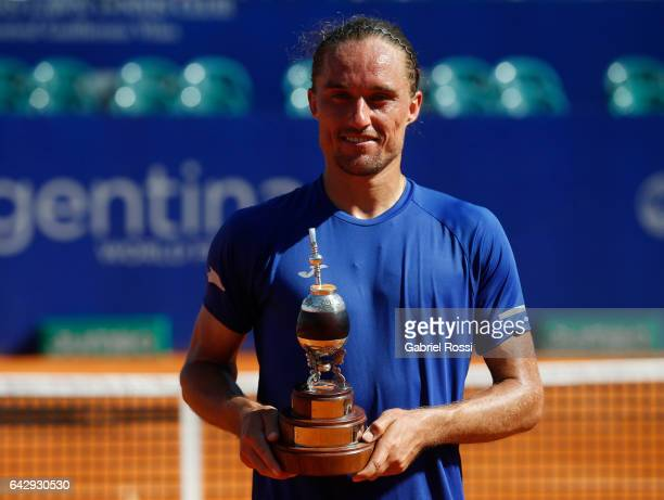 Alexandr Dolgopolov of Ukraine poses with the trophy after wining the final match between Kei Nishikori of Japan and Alexandr Dolgopolov of Ukraine...
