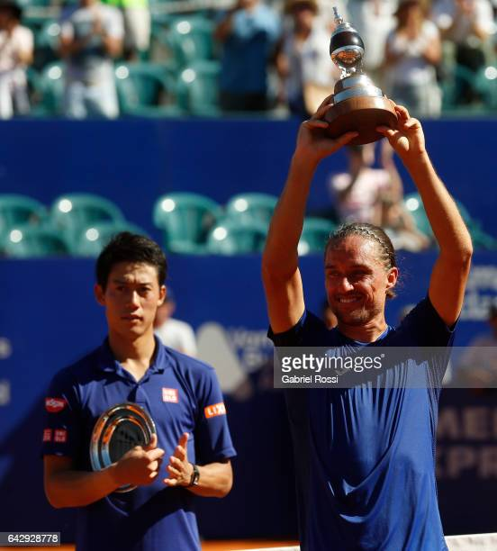 Alexandr Dolgopolov of Ukraine raises the trophy after winning the final match between Kei Nishikori of Japan and Alexandr Dolgopolov of Ukraine as...