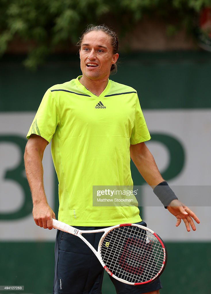 Alexandr Dolgopolov of Ukraine reacts during his men's singles match against Marcel Granollers of Spain on day four of the French Open at Roland...
