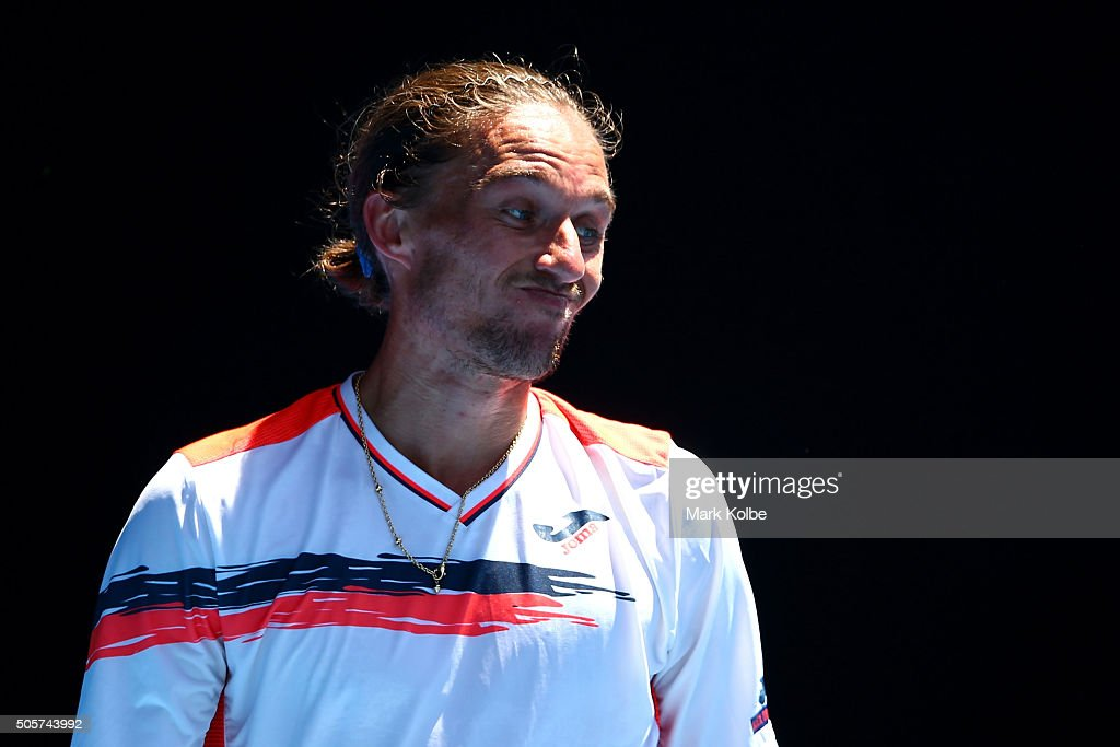 Alexandr Dolgopolov of Ukraine reacts in his second round match against Roger Federer of Switzerland during day three of the 2016 Australian Open at...