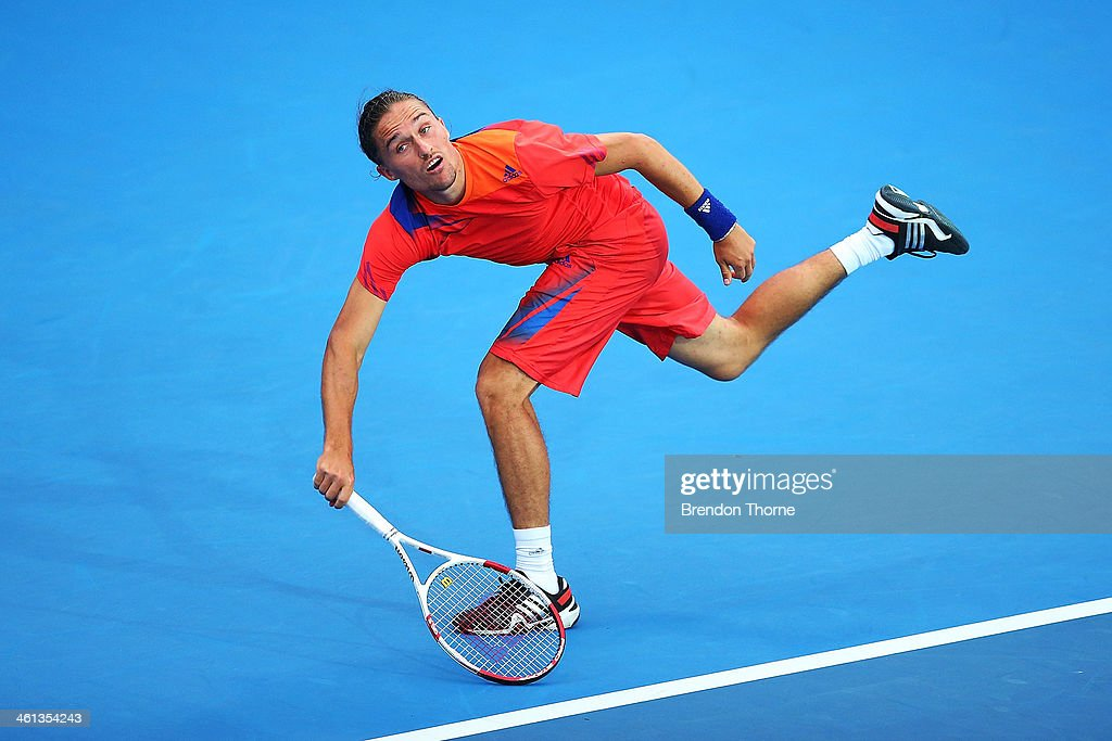 <a gi-track='captionPersonalityLinkClicked' href=/galleries/search?phrase=Alexandr+Dolgopolov&family=editorial&specificpeople=7025085 ng-click='$event.stopPropagation()'>Alexandr Dolgopolov</a> of Ukraine receives serve in his second round match against Jerzy Janowicz of Poland during day four of the 2014 Sydney International at Sydney Olympic Park Tennis Centre on January 8, 2014 in Sydney, Australia.
