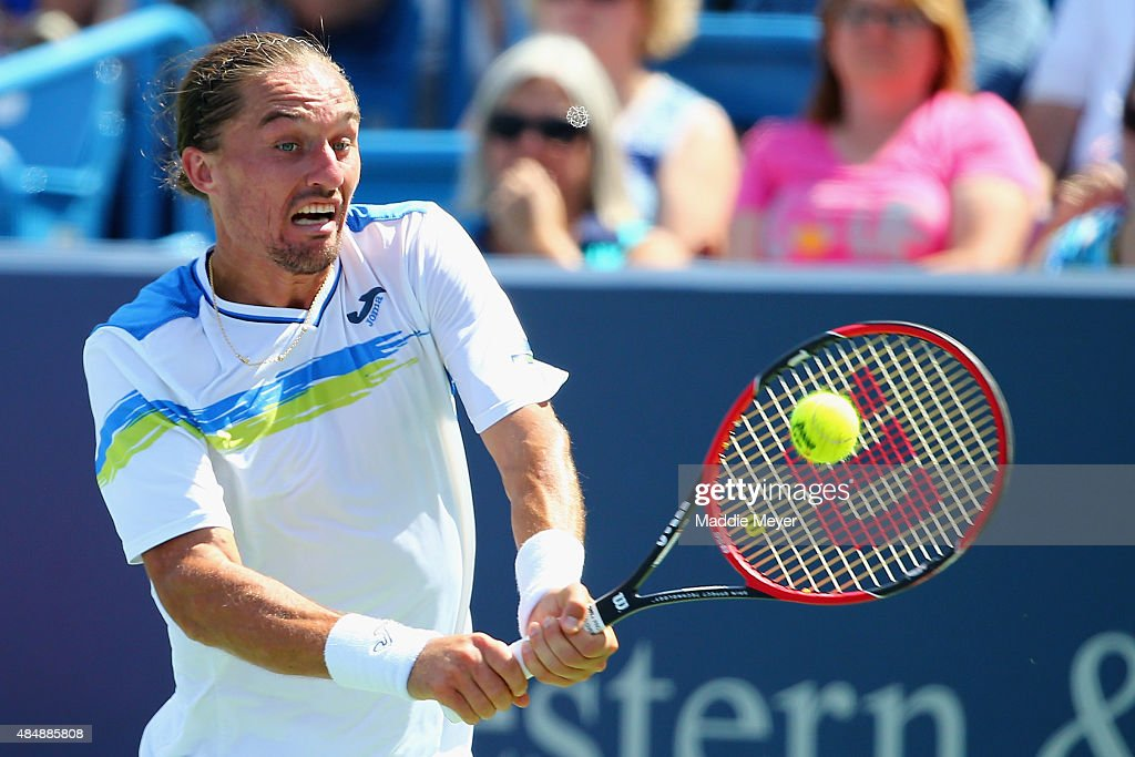 Alexandr Dolgopolov of Ukraine returns a backhand to Novak Djokovic of Serbia during their semifinal match on Day 8 of the Western Southern Open at...