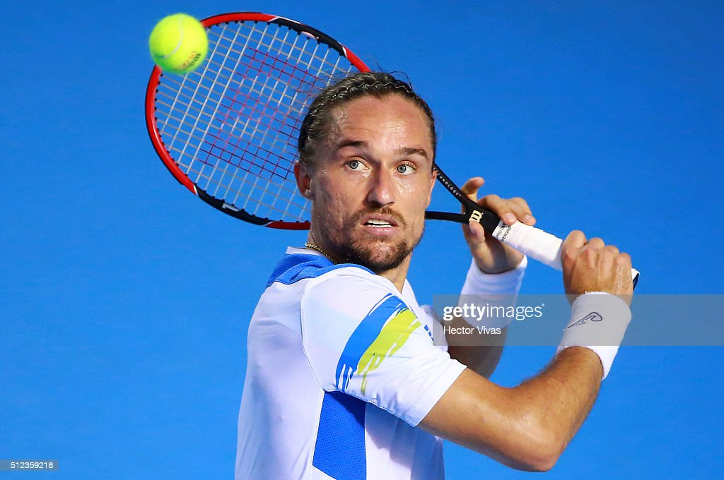Alexandr Dolgopolov of Ukraine returns a ball during a singles match between Alexandr Dolgopolov of Ukraine and Robin Haase of The Netherlands as...