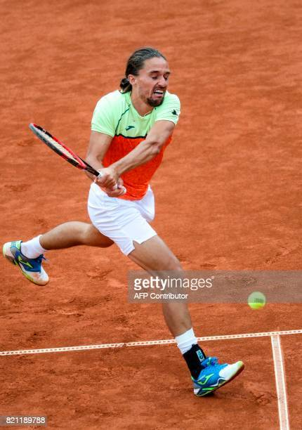 Alexandr Dolgopolov of Ukraine returns a ball to David Ferrer of Spain during the singles final match of the Swedish Open ATP tennis tournament in...