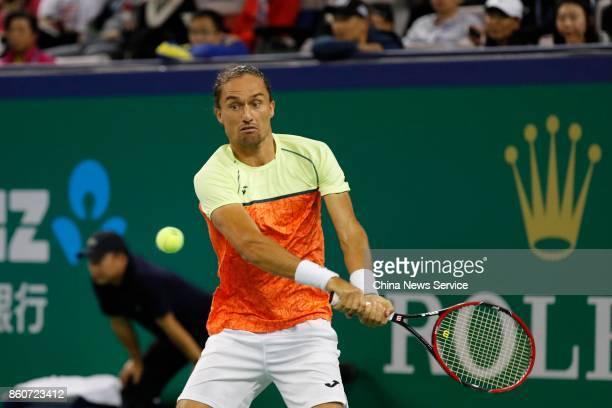 Alexandr Dolgopolov of Ukraine returns a shot against Roger Federer of Switzerland in the Men's singles third round match on day 5 of 2017 ATP...