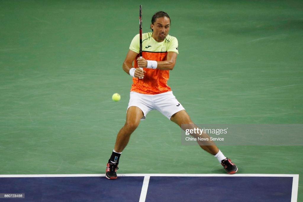 Alexandr Dolgopolov of Ukraine returns a shot against Roger Federer of Switzerland in the Men's singles third round match on day 5 of 2017 ATP Shanghai Rolex Masters at Qizhong Stadium on October 12, 2017 in Shanghai, China.