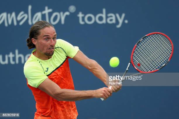 Alexandr Dolgopolov of Ukraine returns a shot to Nick Kyrgios of Australia during Day 5 of the Western Southern Open at the Linder Family Tennis...