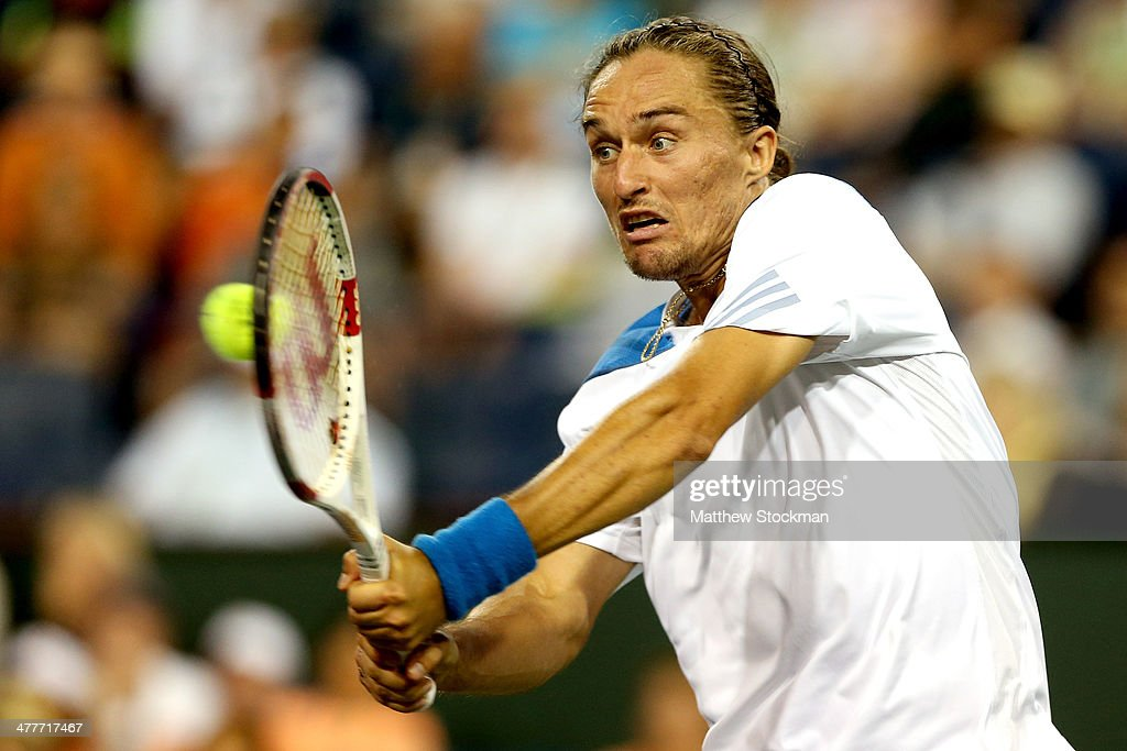 <a gi-track='captionPersonalityLinkClicked' href=/galleries/search?phrase=Alexandr+Dolgopolov&family=editorial&specificpeople=7025085 ng-click='$event.stopPropagation()'>Alexandr Dolgopolov</a> of Ukraine returns a shot to Rafael Nadal of Spain during the BNP Parabas Open at the Indian Wells Tennis Garden on March 10, 2014 in Indian Wells, California.