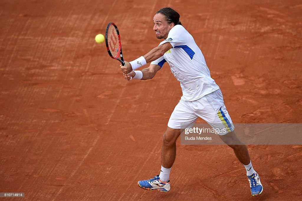 Alexandr Dolgopolov of Ukraine returns a shot to Thomaz Bellucci of Brazil during the Rio Open Day 2 at Jockey Club Brasileiro on February 16 2016 in...