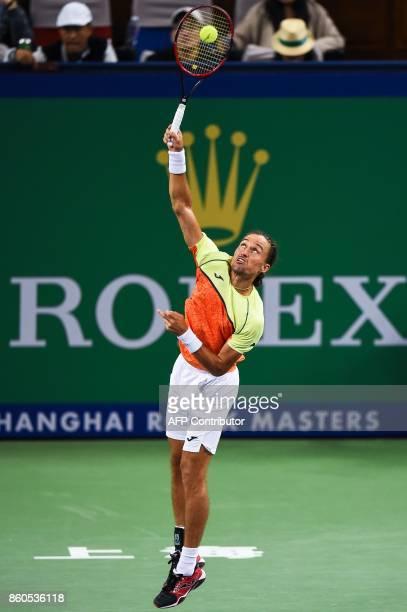Alexandr Dolgopolov of Ukraine serves during the men's singles against Roger Federer of Switzerland at the Shanghai Masters tennis tournament in...