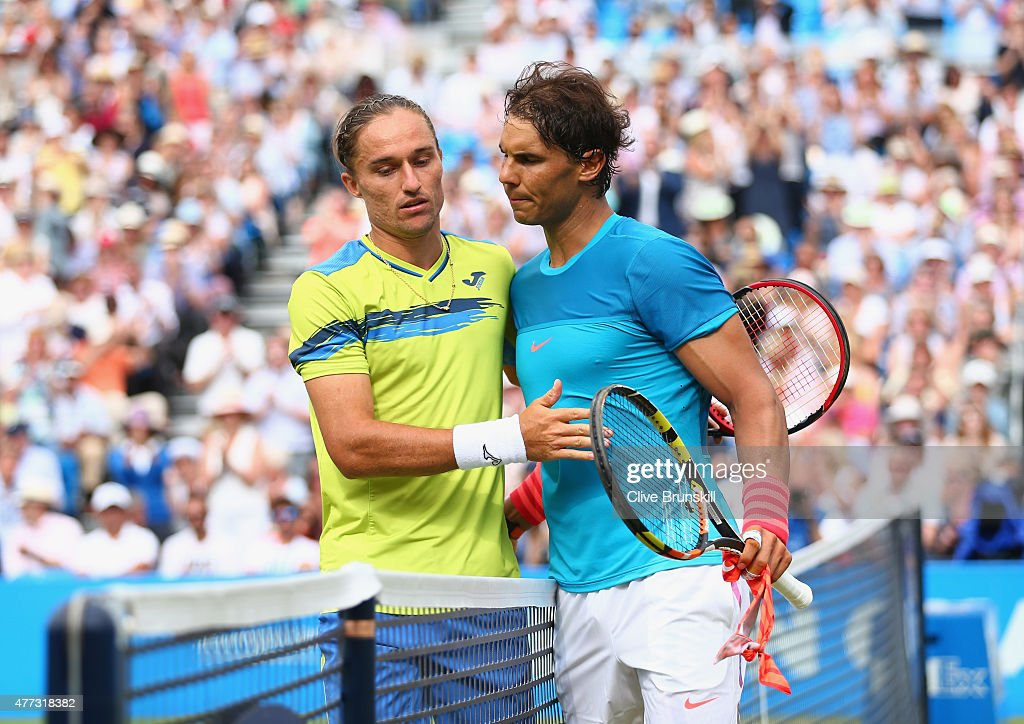 <a gi-track='captionPersonalityLinkClicked' href=/galleries/search?phrase=Alexandr+Dolgopolov&family=editorial&specificpeople=7025085 ng-click='$event.stopPropagation()'>Alexandr Dolgopolov</a> (L) of Ukraine shakes hands with <a gi-track='captionPersonalityLinkClicked' href=/galleries/search?phrase=Rafael+Nadal&family=editorial&specificpeople=194996 ng-click='$event.stopPropagation()'>Rafael Nadal</a> of Spain after their men's singles first round match against during day two of the Aegon Championships at Queen's Club on June 16, 2015 in London, England.