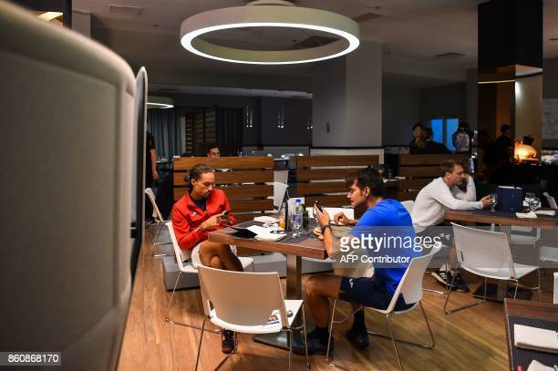 Alexandr Dolgopolov of Ukraine sits inside the player's lounge at the Shanghai Masters tennis tournament in Shanghai on October 13 2017 / AFP PHOTO /...
