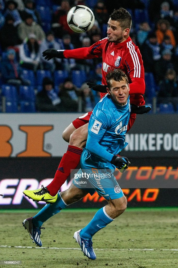 Alexandr Kerzhakov of FC Zenit St. Petersburg (in front) and Milan Perendija of FC Mordovia Saransk vie for the ball during the Russian Football League Championship match between FC Zenit St. Petersburg and FC Mordovia Saransk at the Petrovsky Stadium on March 17, 2013 in St. Petersburg, Russia.