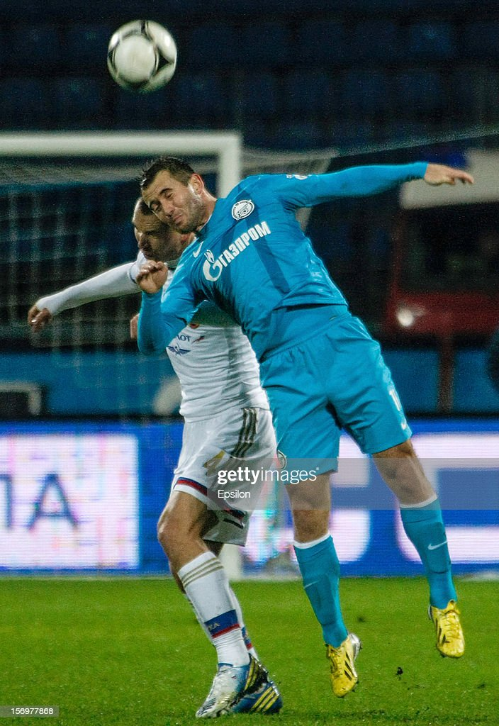 Alexandr Kerzhakov of FC Zenit St. Petersburg (R) and Sergei Ignashevich of PFC CSKA Moscow vie for the ball during the Russian Football League Championship match between FC Zenit St. Petersburg and PFC CSKA Moscow at the Petrovsky Stadium on November 26, 2012 in St. Petersburg, Russia.