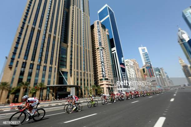 Alexandr Pliuschin of Moldova and Skydive Dubai Pro Cycling Team races down Sheikh Zayed Road during stage four of the Dubai Tour on February 8 2014...