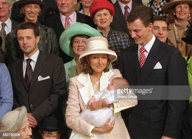 Alexandra and Joachim with their baby in the background the godparents and Frederik among them