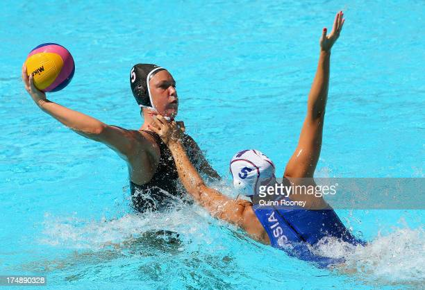 Alexandra Antonova of Russia tackles Monika Eggens of Canada during the Women's Water Polo quarterfinal match between Russia and Canada during day...