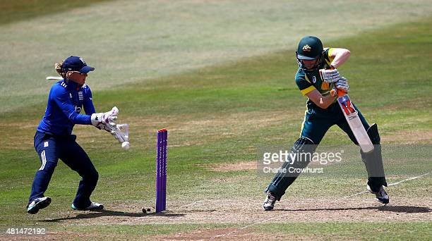 Alexandra Blackwell of Australia hits out while Sarah Taylor of England looks on during the 1st Royal London ODI of the Women's Ashes Series between...