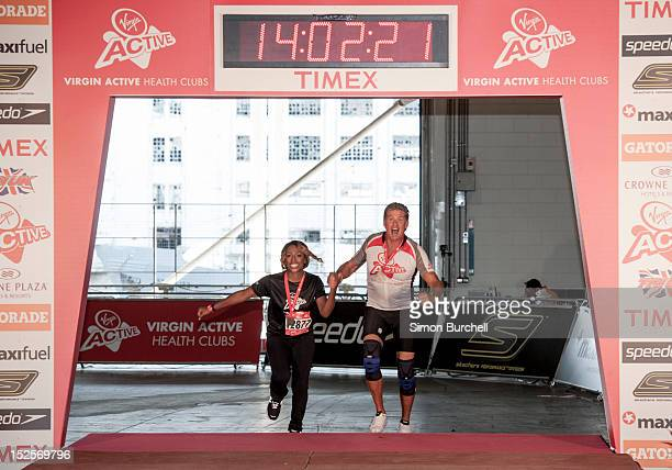Alexandra Burke and David Hasselhoff competing in the Virgin Active London Triathlon at ExCel on September 22 2012 in London England